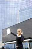 Lady with mobile phone behind office building. Royalty Free Stock Photo