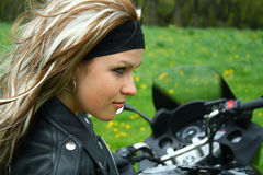 Lady on motorbike. Young woman on a motorbike stock photo