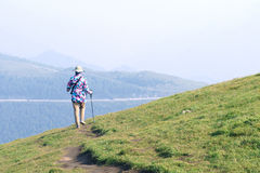 Lady in mountain. A lady walks on the hillside royalty free stock photos