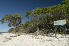 Lady Musgrave Island beach. Capricornia Cays Park Sign near trees on beach of Lady Musgrave Barrier Reef island Royalty Free Stock Photo