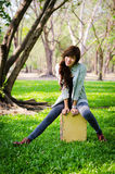 Lady musician. Sitting on the cajon in public park Stock Images