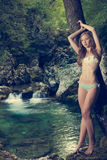 Lady nature - beoutiful young wman dressed in swimwear stands in Royalty Free Stock Photography