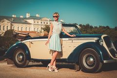 Lady near classic convertible Royalty Free Stock Photos
