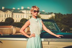Lady near classic convertible Stock Photography