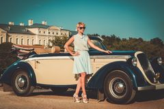 Lady near classic convertible Royalty Free Stock Images