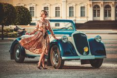 Lady near classic convertible Royalty Free Stock Image