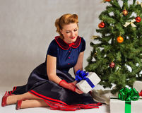 The lady next to Christmas tree Stock Images