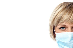 Lady nurse with face mask Royalty Free Stock Images