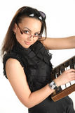 Lady and the old calculator. Girl with glasses holding an old calculator Stock Photography
