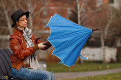 Lady opening blue umbrella Royalty Free Stock Images