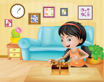 A lady opening her gift in the living room Stock Image