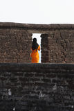 Lady in Orange. Muslim lady wearing orange saree at St. Angelo's Fort in Kannur, Kerala Stock Image