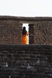 Lady in Orange Stock Image