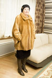 Lady in orange mink furcoat Royalty Free Stock Photo