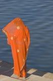 Lady In Orange Sari Royalty Free Stock Photography