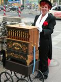Lady Organ Player in Berlin. Lady playing an organ on the street in Berlin. This organ built byOrgelbau Stüber, is a copy of the Harmonipan organ built by stock photo
