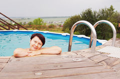 Lady in an outdoor pool Stock Images