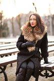 Lady outdoors lifestyle. Young business lady in the park is enjoying winter Royalty Free Stock Photos