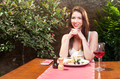 Lady outside on terrace wafting to have lunch. Beautiful lady smiling outside on terrace and wafting to have lunch and wine with copy text space Stock Images