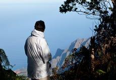 Lady overlooks Na Pali Coast Stock Photo