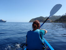 Lady Paddles Kayak toward Catalina Island Stock Images