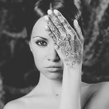 Lady with painted hands mehendi Stock Images
