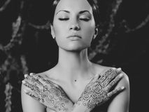 Lady with painted hands mehendi Stock Image