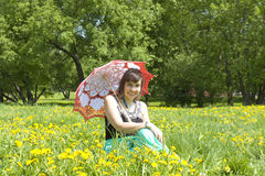 Lady with parasol and yellow dandelions Royalty Free Stock Image