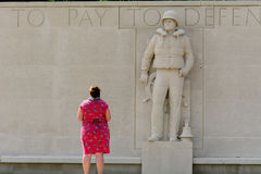 Lady paying respects at war cemetery Stock Images