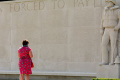 Lady paying respects at war cemetery Stock Photo