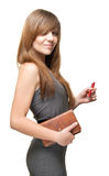Lady with pen and datebook smiles. A pretty young woman in a dress with a red ball-point pen  and a personal organizer sweet smiles Royalty Free Stock Photos