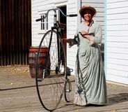 Lady And Penny Farthing Bicycle Royalty Free Stock Photos