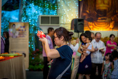 A Lady Performing Ritual During Vesak Day stock photography