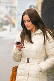 Lady and phone Stock Photography