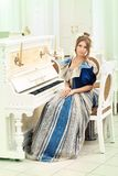 Lady and piano Stock Photo