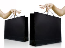 Lady pick up glossy black shopping bag Royalty Free Stock Photography