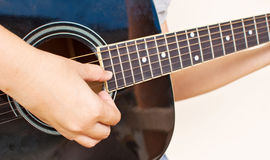 Lady picking classic acoustic guitar. Stock Images