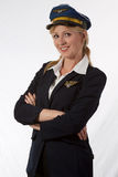 Lady pilot. Attractive blond woman wearing pilot uniform with arms crossed smiling royalty free stock photography