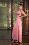 Lady in pink. An attractive blonde woman in an elegant pink dress Royalty Free Stock Photos