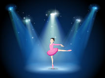 A lady in pink dancing ballet with spotlights Stock Photography