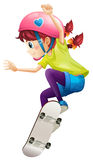A lady with a pink helmet skateboarding Royalty Free Stock Image