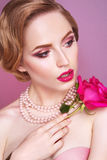 Lady with pink rose. Lady with pink rose and bright makeup Royalty Free Stock Image
