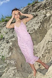 Lady in a pink scaly sundress on sand quarry Royalty Free Stock Photos