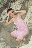 Lady in a pink scaly sundress on sand quarry Stock Images