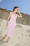 Lady in a pink scaly sundress on sand quarry Stock Photos