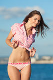Lady in pink shirt on the beach Stock Image