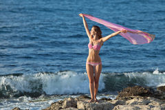 Lady in pink swimwear at the sea Royalty Free Stock Photo
