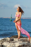 Lady in pink swimwear at the sea Royalty Free Stock Image