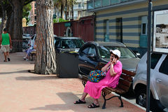 Lady in pink talking on the phone Stock Photo
