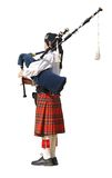 Lady Piper. A woman playing the pipes during a competition stock photo